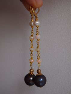 Excited to share the latest addition to my #etsy shop: Lovely Black pearl drop earrings,Tahitian pearl earrings,natural opal earrings,gold filled opal earrings,Welo Ethiopian opal,gift for her Handmade and designed by ZahidasJewellery #black pearl earrings drop #black pearl earrings gold #black pearl earrings Tahitian #black pearl earrings dangle