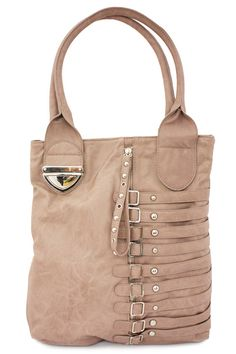 Sloane reminds us of Kinsley's equally sleek older sister! This soft mauve tote gets structure from smooth straps with silver buckle detailing, allowing for major transition from workday to weekend.
