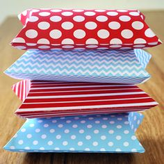 Easy to print and fold pillow boxes in four different designs.