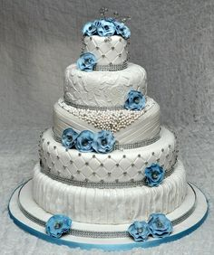 Vintage wedding cake with beads,lace, quilting, drapes and flowers