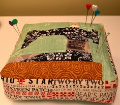"""I ❤ crazy quilting . . . Pincushion-   I keep poking myself when I pick up my thinner pincushions and the pins poke through so I made this one thick - it is about 2.5"""" thick. I used one of the text prints from Sweetwater's Mama Said Sew.  ~By shecanquilt"""