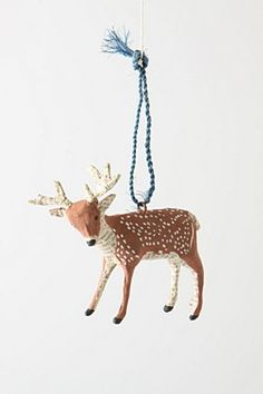 anthropolgie diy: dollar store animals as ornaments. Paint, glittler, etc