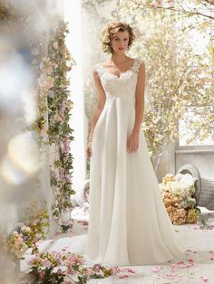 Exquisite A-Line/Princess Sleeveless V-neck Chiffon Sweep/Brush Train Wedding Dress