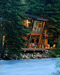 River House Glows Like a Lantern in the Woods - under deck lights give Dining Room guests a view of the river and landscape from the angular windows. Architecture by David Johnston Architects, Aspen, Colorado. - My dream home! Architecture Design, Angular Architecture, Windows Architecture, Vintage Architecture, Landscape Architecture, Landscape Design, Beautiful Homes, Beautiful Places, Haus Am See