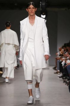 It's been a while since Korean designer Juun J garnered such a thundering round of applause at the end of his show as he did today for his spring summer 2015 show. But hot on the heels of last ...