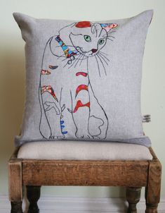 Applique cat cushion. $45.00, via Etsy.