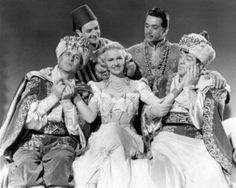 Lost in a Harem - publicity photo with (front row) Lou Costello, the lovely Marilyn Maxwell, Bud Abbott - http://abbott-and-costello-whos-on-first.info/lost-in-a-harem/