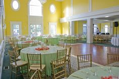 Twinbrook Floral Design -- I just love that far wall with the sunny yellow paint and the white trim around those beautiful old-style windows.