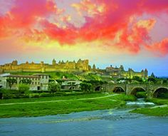 Clouds turned scarlet by the sunset float above Carcassonne, a fortified town in the south that has been occupied since around 350 B.C.