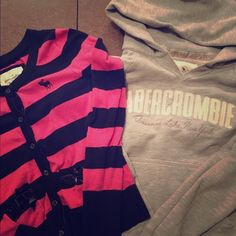 Reposh Abercrombie Bundle both size large Size large Abercrombie and Fitch bundle: pink/blue long sleeved button cardigan with cute velvet bow detailing on front pockets and grey with white lettering hooded sweatshirt. Love these both so much but I'm a bit too busty for them to fit properly. I own Several Abercrombie  tops in size large – but these fit more like a medium in my opinion. They're both in awesome condition! Abercrombie & Fitch Sweaters Cardigans