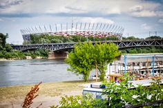 National Stadium (Stadion Narodowy) with Srednicowy railway bridge over the Vistula (Wisla) riverbanks, Warsaw, Poland