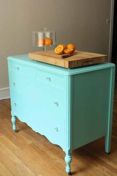 light turquoise kitchen island dresser. This is cute but maybe a different color since I want turquoise kitchen walls. Good idea for the lack of counter tops.