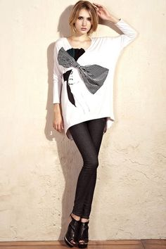 The T-shirt made of cotton, featuring V-neckline styling, long bat sleeves, bowknot embellishment to chest, high low hem design, all in loose fit.$68