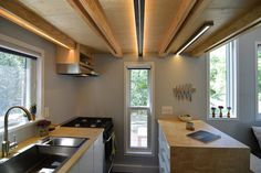 SHED tiny house, tiny house, tiny home, kitchen, interior, cooking