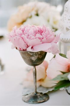 Great idea.  I have silver goblets that would look beautiful with a single flower in each.