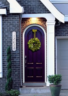 Great Feng Shui front door: open and welcoming; purple door welcomes prosperity; wreath is welcoming, too; address is very clear and easy to see.