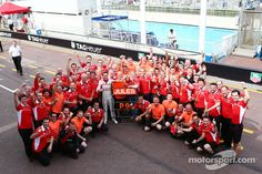 Jules Bianchi, Marussia F1 Team celebrates his and the team's first F1 points with the team | Main gallery | Photos | Motorsport.com