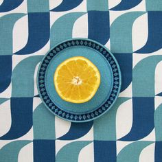 The 'Aperture' Table Runner by Skinny laMinx is perfect for as a dinner party centrepiece.