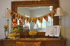 Winnie the Pooh Baby Shower - colors: main - ivory, yellow, red, brown; accents - green and blue/aqua.