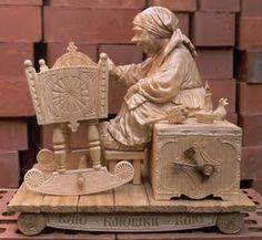 Weefolk rocking the baby wood sculpture
