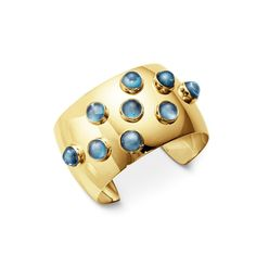 Michelsen London Blue topaz cuff in yellow gold by Georg Jensen. Discover the birthstone jewellery of November with a cool icy blue hue: http://www.thejewelleryeditor.com/jewellery/top-5/top-5-blue-topaz-jewellery-november-birthstone/ #jewelry