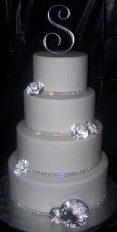 Wedding Cake Bling; Beautiful Cakes That Sparkle & Shine | IDEAL PR MEDIA - Large Falling Diamonds. Simple, Elegant. Place a large Faux Diamond ring or stone as a cake topper in place of the letter as shown