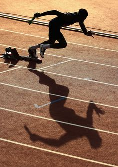 An athlete leaves the blocks at the start of the Men's metres relay heats at Hampden Park during day nine of the Glasgow 2014 Commonwealth Games on August 2014 in Glasgow, United Kingdom. Shadow Photography, Sport Photography, Fitness Photography, Running Pictures, Track Pictures, Poses, Track Quotes, Commonwealth Games, Track Workout