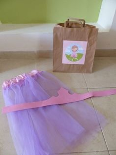 Princess and knight birthday - gift bags for the kids. The boys got a knight's tunic and a cardboard shield to decorate. The girls got a princess skirt and a foam crown to decorate.