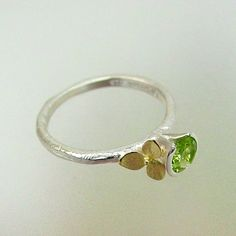 http://www.etsy.com/listing/82708420/hydrangea-stacking-ring-sterling-silver?ref=fp_recent