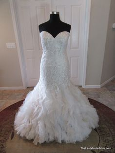 Description Allure Bridals Wedding Dress Style 9254 Gorgeous mermaid silhouette bridal gown with a sweetheart neckline, fitted elongated lace bodice. A ruffled organza skirt finishes this look. The ba