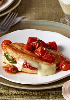 Mozzarella-Basil Chicken with Roasted Tomatoes — Chicken breasts are stuffed with fresh basil, melty mozzarella and sun-dried tomatoes. The best part? It's better for you too!