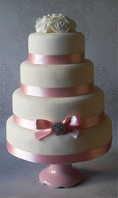 traditional #cake with satin #ribbon on each tier. #bridalmentor - For more inspiration, follow us on Facebook - https://www.facebook.com/TheBridalMentor.