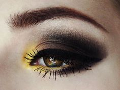 Vibrant Yellow and Dark Brown Smokey Eye. Great for wearing leopard print!