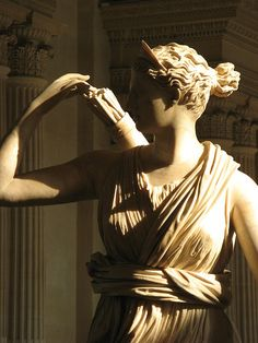 artémis - a statue of the greek goddess artemis at the louvre