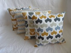 This is a set of FOUR new handmade 14 (approx 36cm) cushion covers - a pretty shabby chic/scandi style mix of prints in shades of mustard/saffron yellow, blue and grey . You will receive one cover in each of the four fabrics - four covers in total. (please note it is the cushion/pillow covers only - you will need to supply your own fillers) The backs of the covers are made with a plain ivory fabric and have an envelope opening (no fiddly zips) as can be seen in the last photo. As each…