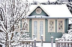 blue cottage in winter woods--Can you imagine on such a frosty day, walking into the warmth and comfort of this little house?