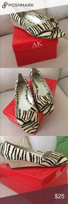 Anne Klein zebra wedge shoes These cute wedges are in excellent used condition. Only visible wear is on bottom of soles. Fabric is clean. Wedges are not scuffed. Smoke free home AK Anne Klein Shoes Wedges