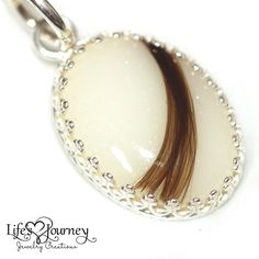 Breastmilk and lock of hair keepsake jewelry; vintage oval pendant with lock of hair and preserved breastmilk; heirloom jewelry https://www.lifesjourneyjewelrycreations.com