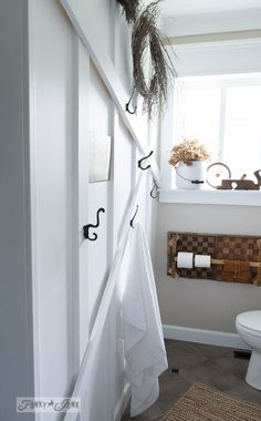 ceiling touge & groove also Board and batten attic styled white wall / Salvaged farmhouse bathroom makeover via www. Wood Bathroom, Small Bathroom, Bathroom Ideas, Bathrooms, Bathroom Storage, Master Bathroom, Diy Bathroom Remodel, Bath Remodel, Funky Junk Interiors