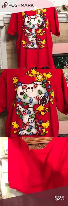 Precious Snoopy Christmas tee shirt All tangled in brightly colored light, Snoopy has been transformed into a Christmas tree!! Nice and roomy and very comfy even to sleep in. Excellent condition. Peanuts Tops Tees - Short Sleeve