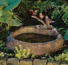 love little bird baths tucked in the garden