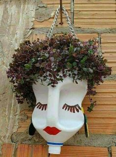 As plantinhas vão ter uma cariinspiration for a Scarecrow head or jazz up for a display of head planters.*clever use to repurpose bleach and other jugs!Ideas For Garden Art Crafts PlantsCrochet Patterns Vintage Queen of Hearts / Alice in Wonderland Plastic Bottle Planter, Plastic Bottle Crafts, Plastic Bottles, Bottle Garden, Garden Pots, Balcony Garden, Garden Crafts, Garden Projects, Garden Ideas
