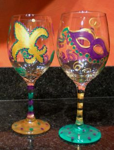 Mardi Gras wine glasses - love the use of golden accents against purple and green