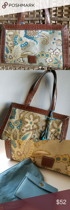 """Liz Claiborne purse, brown and blue floral, NWOT New Liz Claiborne purse, without tags. Brown and blue tapestry type floral fabric, with a very light and subtle  gold sheen on the fabric. Soft gold trim and bead tie on accessory. Magnetic 2"""" closure.    Includes small zipper pouch and small wallet in matching fabric.  Many compartments including two with zippers.     12.5"""" length,  8.25"""" deep,  4"""" across. Liz Claiborne Bags Totes"""