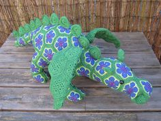 Made my own Smaug the African Flower dragon. Love it! Pattern is from Heidi Bears.  http://meisjetheelepelhaakt.wordpress.com/2014/11/08/smaug-the-african-flower-dragon-heidi-bears/