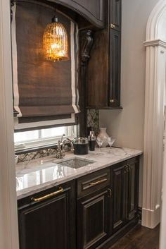 Get inspired by Traditional Kitchen Design photo by Vanessa Deleon Associates. Wayfair lets you find the designer products in the photo and get ideas from thousands of other Traditional Kitchen Design photos. Kitchen Designs Photos, House Design Photos, Wet Bar Cabinets, Black Cabinets, Dark Stained Cabinets, Kitchen Wet Bar, Kitchen Decor, Wet Bar Designs, Traditional Kitchen