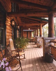 Lively chats are bound to be had on this cozy rustic covered porch with comfortable rocking chairs.
