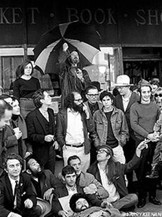 Lawrence Ferlinghetti wanted to document the 1965 Beat scene in San Francisco in the spirit of the early 20th century classic photographs of the Bohemian artists  writers in Paris.The Beats, front row L to R: Robert LaVigne, Shig Murao, Larry Fagin, Leland Meyezove, Lew Welch, Peter Orlovsky.Second row: David Meltzer, Michael McClure, Allen Ginsberg, Daniel Langton, Steve (friend of Ginsberg), Richard Brautigan, Gary Goodrow, Nemi Frost.Back row:Stella Levy, Lawrence Ferlinghetti…