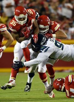 Seattle Seahawks vs. Kansas City Chiefs - Running back Charcandrick West #35 of the Kansas City Chiefs carries the ball during the preseason game against the Seattle Seahawks at Arrowhead Stadium on August 21, 2015 in Kansas City, Missouri.