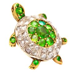 Demantoid Garnet and Diamond Turtle Brooch | From a unique collection of vintage brooches at https://www.1stdibs.com/jewelry/brooches/brooches/